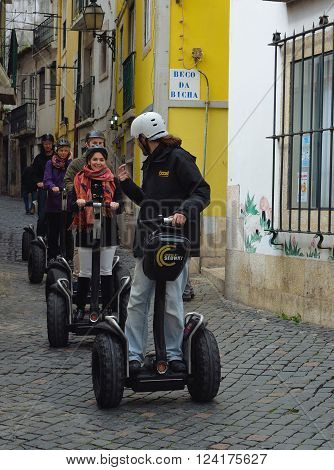 Lisbon, Portugal - March 04, 2016: Tourists on guided Segway tour in the Alfama district of Lisbon Portugal.