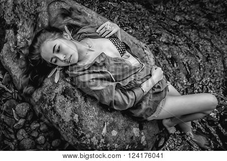 Asia Beautiful Young Sexy Girl Lying Down On A Rock