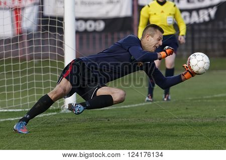 BUDAPEST HUNGARY - APRIL 2 2016: Goalkeeper Andras Horvath of Honved saves the ball during Budapest Honved - Videoton OTP Bank League football match at Bozsik Stadium.