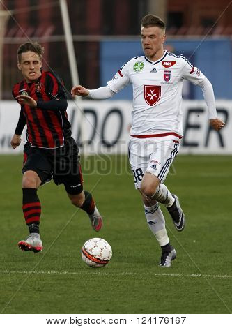 BUDAPEST HUNGARY - APRIL 2 2016: Zsolt Haraszti of Videoton overtakes Gergo Nagy of Honved (l) and during Budapest Honved - Videoton OTP Bank League football match at Bozsik Stadium.