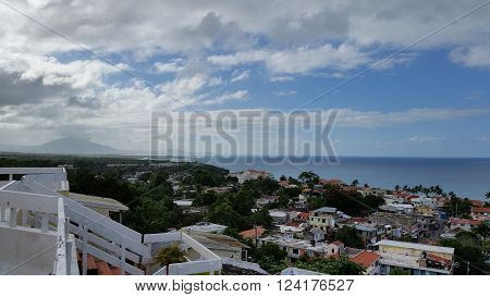 Top view of the city by the sea shore and cloudy sky on the horizon