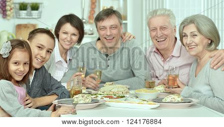 Portrait of happy family at the table with tasty food