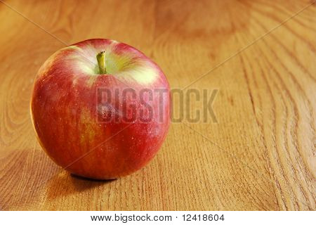 Cortland Apple On Wooden Table