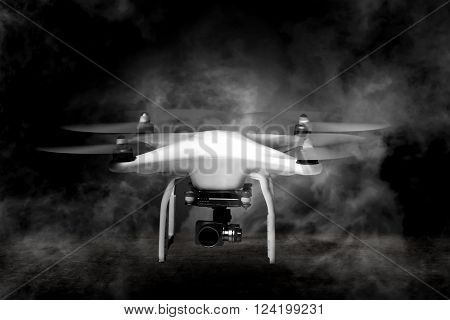 Small white drone with smoke around ready to take off