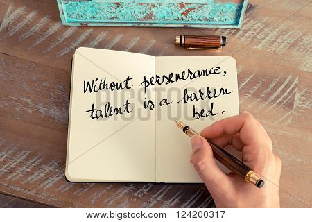 Retro effect and toned image of a woman hand writing on a notebook. Handwritten quote Without perseverance talent is a barren bed as inspirational concept image