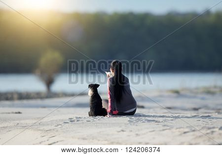 Girl With Dog On Sandy Coast