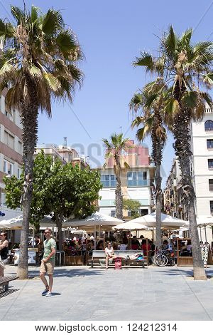 SPAIN, BARCELONA, JUNE, 27, 2015 - Summer cafe on Passeig Maritim  at Barceloneta beach on the seaside in Barcelona, Spain .