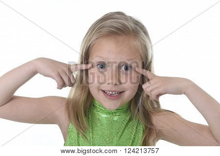 6 or 7 years old little girl with blond hair and blue eyes smiling happy posing isolated on white background pointing eyes in language lesson for child education and body parts school chart serie