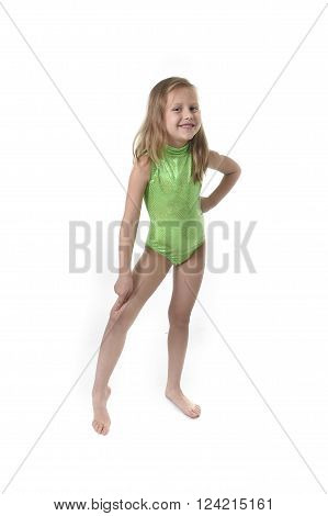 6 or 7 years old little girl with blond hair and blue eyes smiling happy posing isolated on white background pointing knee in language lesson for child education and body parts school chart serie