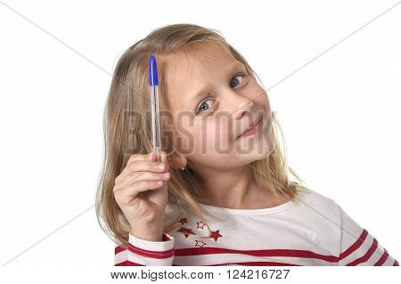 sweet beautiful female child 6 to 8 years old with cute blonde hair and blue eyes holding ball pen isolated on white background in education and primary or junior school supplies concept
