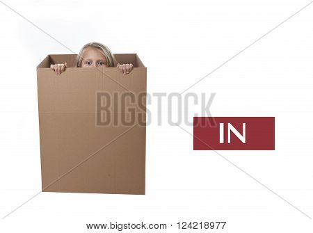 cute and sweet blond hair child hiden in cardboard box isolated on white background in learning english prepositions and words language card set for education school textbook