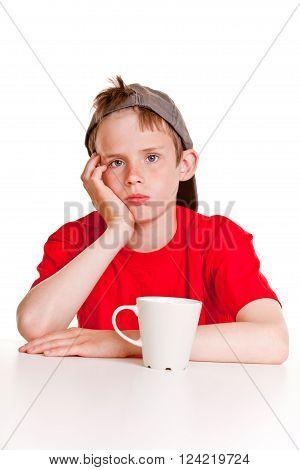 Depressed Boy With White Mug