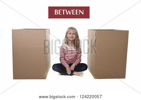 cute and sweet blond hair child sitting between two cardboard boxes isolated on white background in learning English prepositions and words language card set for education school textbook