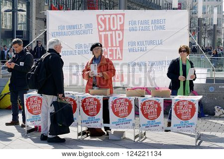 Hannover, Germany - April 02, 2016: Stop TTIP activists handing out leaflets to passers-by. An anti TTIP demonstration is planned for April 23rd to coincide with US President Obama's visit to Hannover.