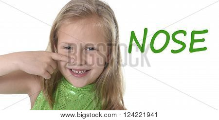 6 or 7 years old little girl with blond hair and blue eyes smiling happy posing isolated on white background pointing nose in learning English language school education body parts card set