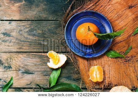 Tangerine On Blue Plate