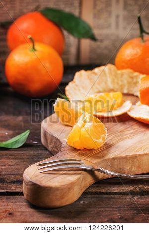 Tangerines On Cutting Board