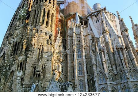 SPAIN, BARCELONA, JUNE, 28, 2015 - The Basilica and Expiatory Church of the Holy Family (Sagrada Familia) is large Roman Catholic Church by Catalan architect Antoni Gaudi, building is begun in 1882 and completion is planned in 2030 in Barcelona, Catalonia