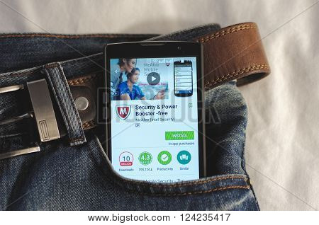 SARANSK, RUSSIA - APRIL 3, 2016: Photo of Smartphone in a jeans pocket with McAfee Security & Power Booster app in a Google Play Store on the screen.
