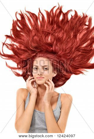Young Beautiful Redhead Woman With Scattered Long Hairs