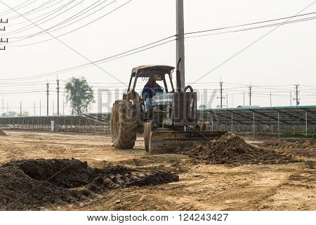 Man Drives Wheel Dozer In The Under Construction Solar Farm
