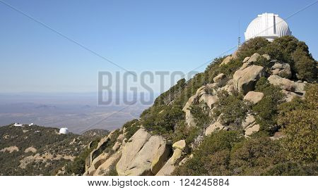 TUCSON, ARIZONA, FEBRUARY 28. Kitt Peak National Observatory on February 28, 2016, near Tucson, Arizona. A view of the WIYN 0.9m telescope looking west from Kitt Peak National Observatory near Tucson Arizona.