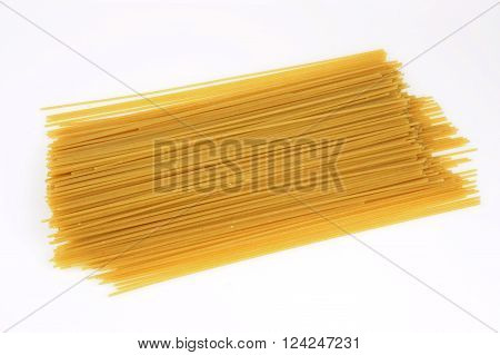 close up on dry spaghetti on white background