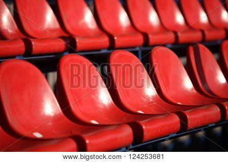 Red chairs bleachers in stadium close to