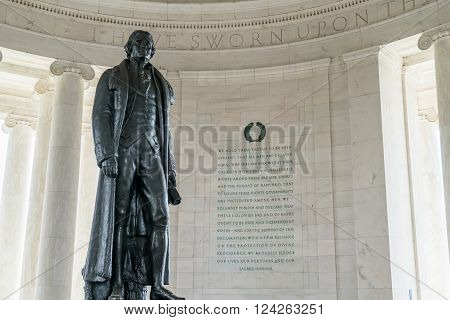Statue of Thomas Jefferson with inscription from the Declaration of Independence inside the Jefferson Memorial in Washington DC