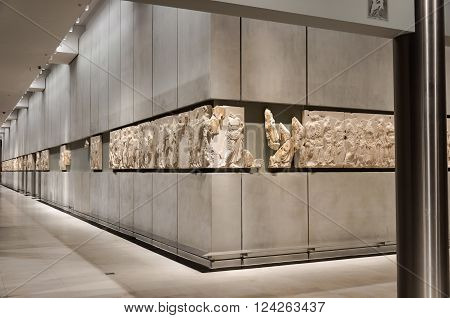 ATHENS GREECE - JANUARY 28 2011: Frieze on the 3rd level of the New Acropolis Museum at night with no people