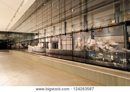 ATHENS GREECE - JANUARY 28 2011: Reflections of the Metopes and Pediment sculptures against the glass windows on the 3rd level of the New Acropolis Museum at night