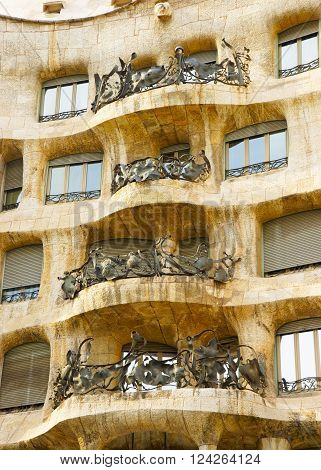 BARCELONA SPAIN - AUGUST 14 2011: Balcony of Casa Mila in Barcelona in Spain. Also called as La Pedrera. In English it is called as Miracle Home or The Quarry. It was designed by Antoni Gaudi Spanish artist