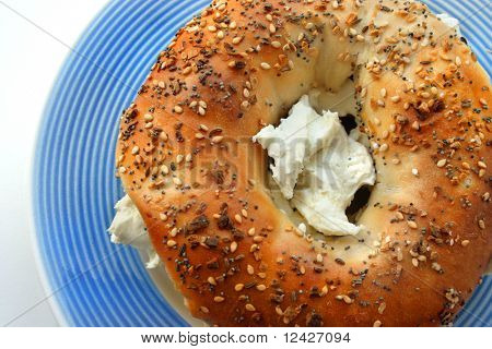 Bagel with cream cheese on plate