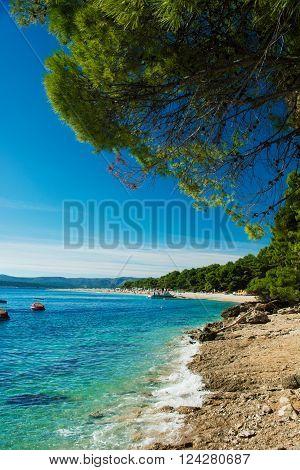 beautiful rocky beach  in Croatia with a view on Zlatni Rat or Golden Cape beach, island Brac