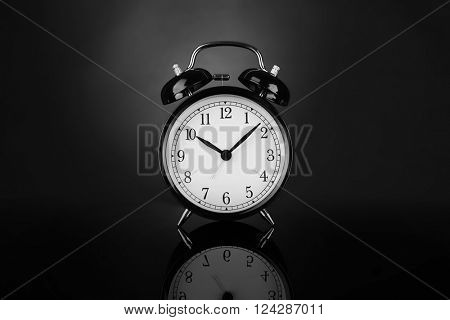 Alarm clock on a black background.