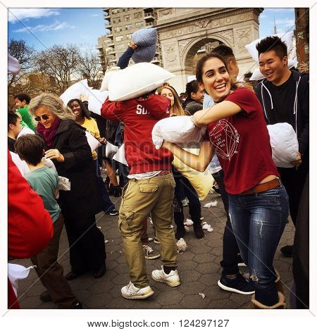 NEW YORK - 02APR16: Participants use pillows to hit one another during International Pillow Fight Day at Washington Square Park on April 2, 2016 in New York City: