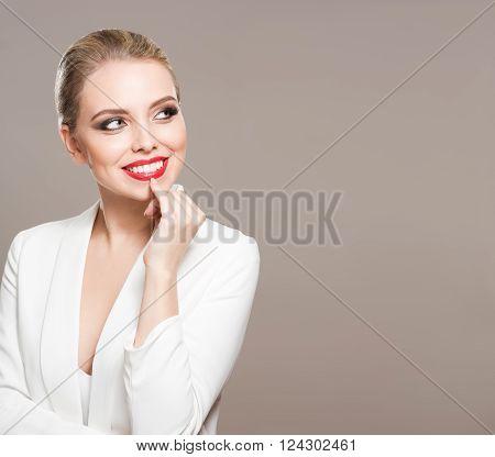 Studio portrait of a blond makeup beauty