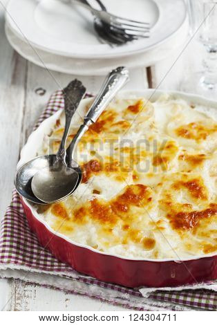Rustic Potato gratin in baking dish ready to serving