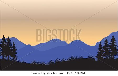 Silhouette of blue mountain at the sunset