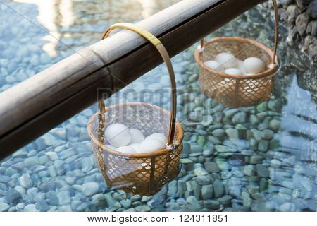 Japanese hot spring steam boil eggs inside basket