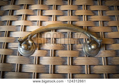 old brass handle on bamboo weaving with vignete