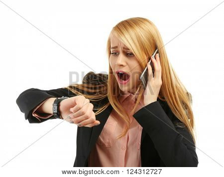 Businesswoman looking at wrist watch, running late for meeting, isolated on white