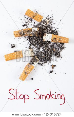 Cigarette butts and ash with inscription stop smoking concept of healthy lifestyles without cigarettes world no tobacco day
