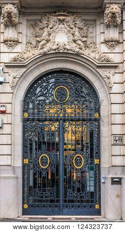 Antwerp Belgium - January 18 2015: Ornate forged door showing the handle and ironwork in the center of Antwerp Belgium