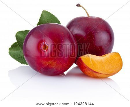Fresh plums with leaves isolated on a white background