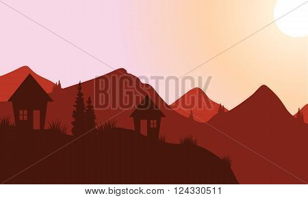 Silhouette of home on the mountain at sunset