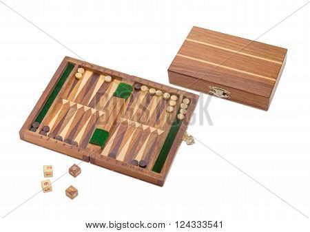 One open and one closed miniature travelling wooden sets to play backgammon on a light background