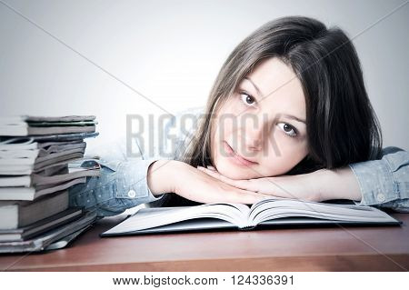 Cute smart young girl studying. Education conceptual image.
