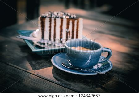 picture of cake and coffee on wood table