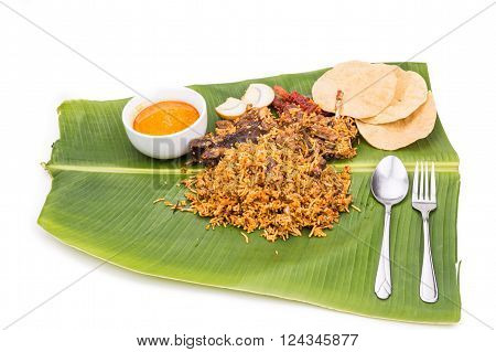 Delicious Nasi Briyani Meal With Mutton,  Dhal On Banana Leaf
